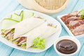 Peking duck chinese roast crispy cucumber and spring onions wrapped in pancakes served with hoisin sauce Stock Photo