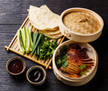 Peking Duck with cucumber, onions, cilantro and pancakes Royalty Free Stock Photo