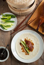 Peking duck served with green onion cucumber pancakes and hoisin sauce Stock Photo