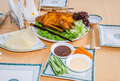 Peking duck served on a table in a restaurant Stock Images