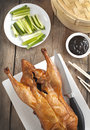 Peking duck on wooden table Royalty Free Stock Photo