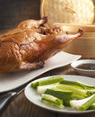 Peking duck on wooden table Stock Image