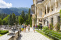 Peles castle garden unidentified group of tourists stroll down the alleys of on july in sinaia romania was declared Stock Photos