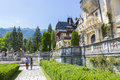 Peles castle garden unidentified tourists having a walk on the alleys of on july in sinaia romania was declared Stock Image