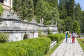 Peles castle garden unidentified tourists stroll down the alleys of on july in sinaia romania was declared museum in Royalty Free Stock Images