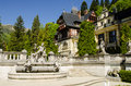 Peles castle in sinaia with the carpathian mountains in the background romania Royalty Free Stock Image