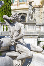 Peles castle sinaia romania allegoric stone male statue of a fountain in garden is the most visited museum in Royalty Free Stock Images