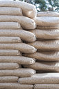 Pellets biomass pine stack of sacks stock photo Royalty Free Stock Image