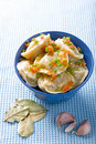 Pelmeni with garlic and bay leaf Royalty Free Stock Photo