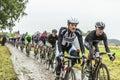 The Peloton on a Cobbled Road- Tour de France 2014 Royalty Free Stock Photo
