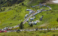 The peloton col de pailheres france july climbing road to col de pailheres in pyrenees mountains through a row of caravans and Stock Images