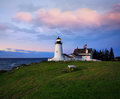 Pemaquid point lighthouse the classic holding vigil in the pre dawn light of another beautiful new england autumn day bristol Stock Images