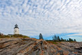 Pemaquid Point Maine lighthouse above rock ledges Royalty Free Stock Image