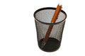 Pen in a black pencil holder on white. Royalty Free Stock Photo