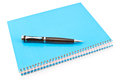 Pen on blue spiral notebook white Stock Image