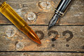 Pen and bullet Royalty Free Stock Photo