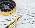 Pen and compass on bank account book Royalty Free Stock Photo