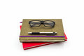 Pen and glasses sitting on book. Royalty Free Stock Photo