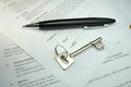 Pen and key on a legal contract black silver an offer to purchase Royalty Free Stock Image