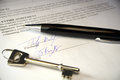 Pen and key on a legal contract black silver an offer to purchase Royalty Free Stock Photo