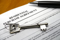 Pen and key on property purchase agreement Royalty Free Stock Photo