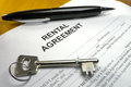 Pen and key on rental agreement black silver a Royalty Free Stock Photography