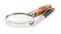 Pen and magnifing glass Royalty Free Stock Photo