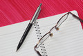 Pen, notebook and spectacles