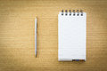 Pen and notepad with blank page Royalty Free Stock Photo