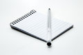 A Pen And Notepad With A Plain...