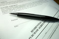 Pen o property purchase agreement black and silver key on an offer to Stock Photography