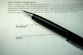 Pen on property purchase agreement black pe an offer to Royalty Free Stock Photography