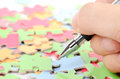 Pen and puzzle Stock Photos