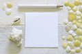 A pen ready to take notes on a white wooden table decorated with some sea shells. Royalty Free Stock Photo