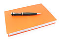 Pen on red notebook isolated white Royalty Free Stock Photo