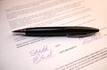 Pen on signatures on a legal document black the Royalty Free Stock Photo