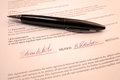 Pen on signatures on a legal document black the Royalty Free Stock Images