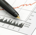 Pen on Stock Price Chart Royalty Free Stock Photo