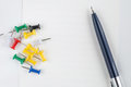 pen and thumbtack on the white paper Royalty Free Stock Photo