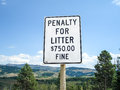 Penalty for littering sign Royalty Free Stock Photo