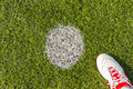Penalty point on soccer pitch artificial grass or indoor futsal with futsal shoe Royalty Free Stock Image