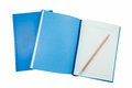 A pencil on blue notebooks isolated on white tif Stock Images