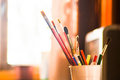 Pencil and brush on cup Royalty Free Stock Photo