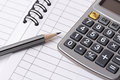 Pencil, calculator and account book Royalty Free Stock Image
