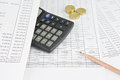 Pencil with calculator and gold coin Royalty Free Stock Photo