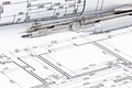 Pencil with drawing compass and rolled plans of architectural bl Royalty Free Stock Photo