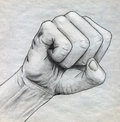 Pencil drawn clinched fist sketch with on rough paper Stock Photography