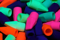 Pencil erasers under black light Royalty Free Stock Photo