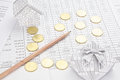 Pencil with gold coins as flower on finance account have house and gift box benefit Stock Image