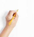 Pencil in hand rubber writting something the Stock Images